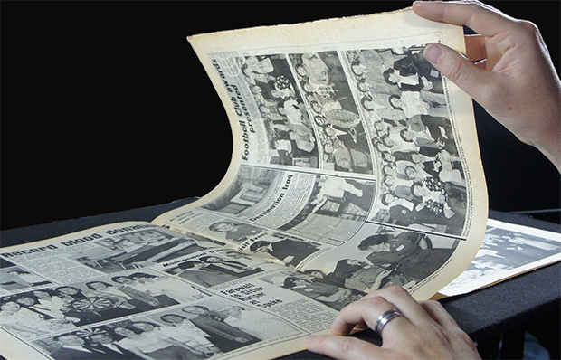 Mark turning newspaper pages