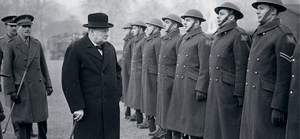 Winston Churchill surveying troops WW2