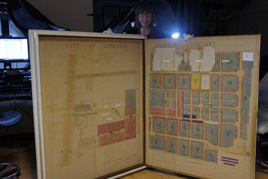 Gemma Cattell alongside the largest map our digitisation team have worked with